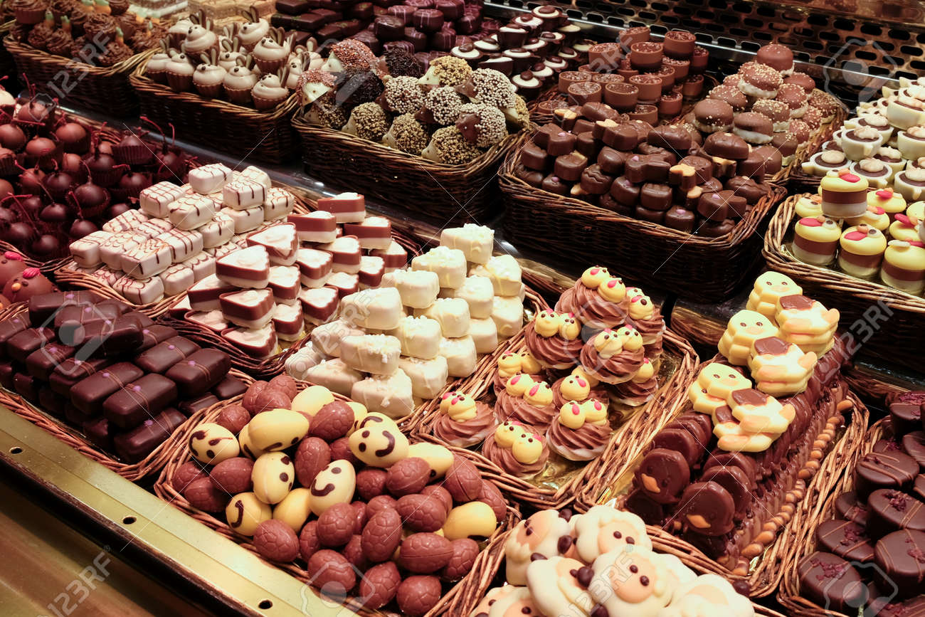A large variety of sweets and cakes on confectionary display. - 158184120