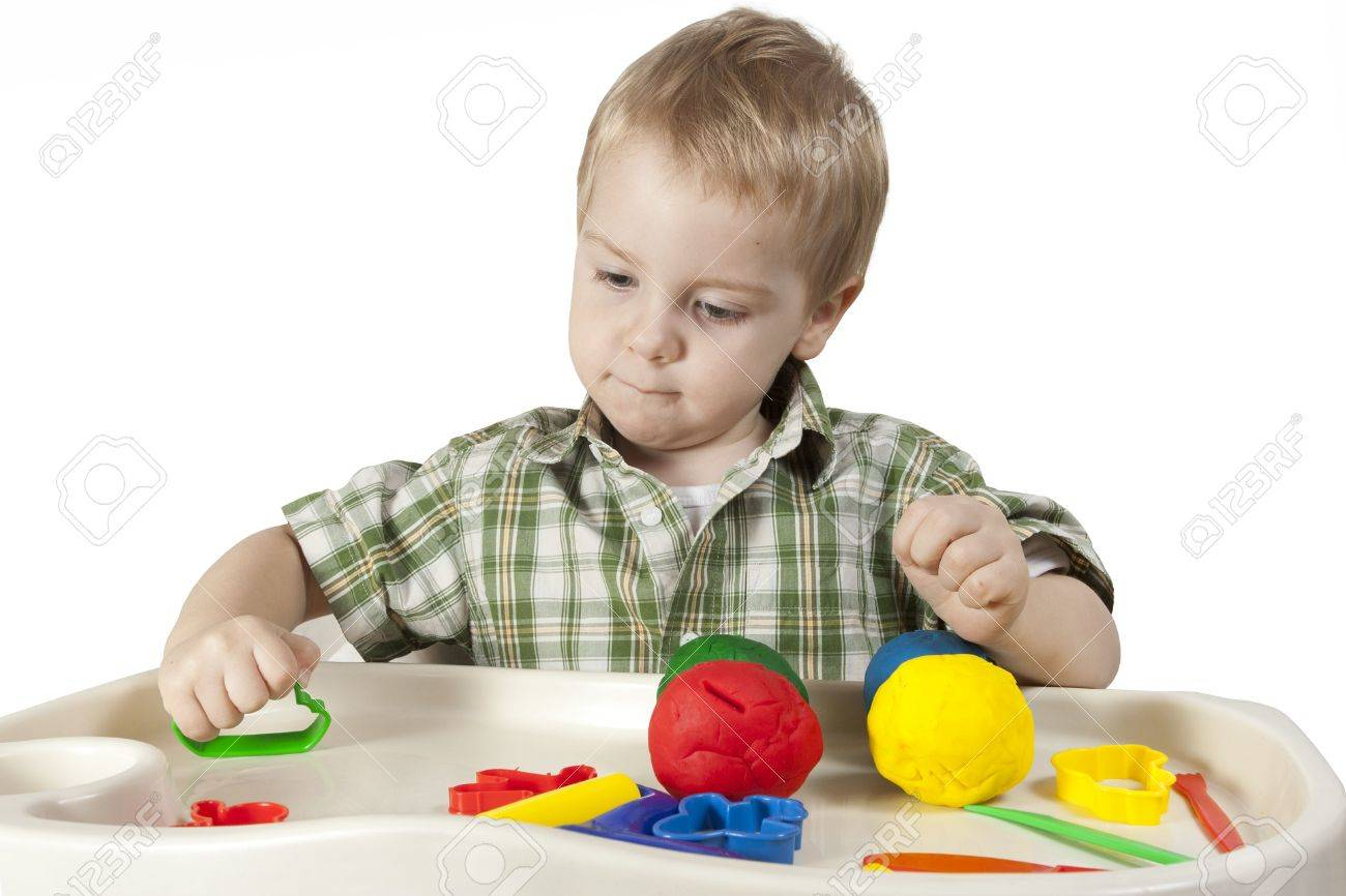 happy child playing with plasticine colorful balls Stock Photo - 7334826