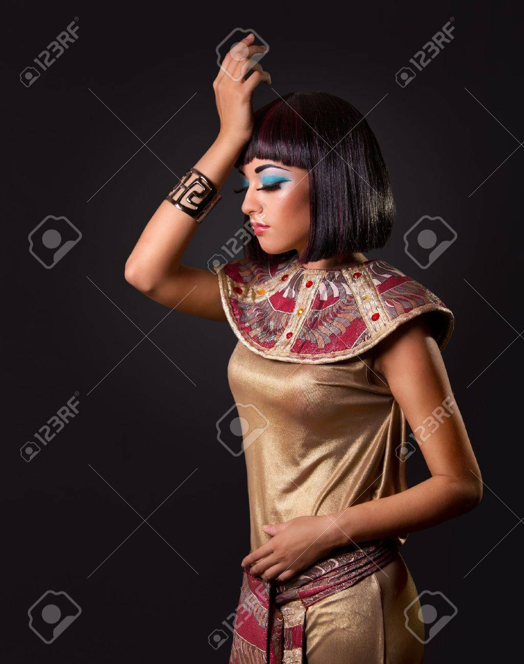 Low key. Looking down. Portrait of a beautiful Egyptian woman. Stage make up Stock Photo - 8474024