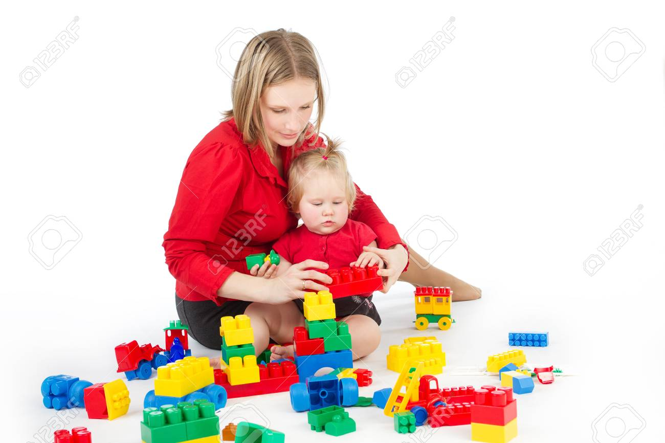 Mother and daughter playing together building blocks over white Stock Photo - 11182862