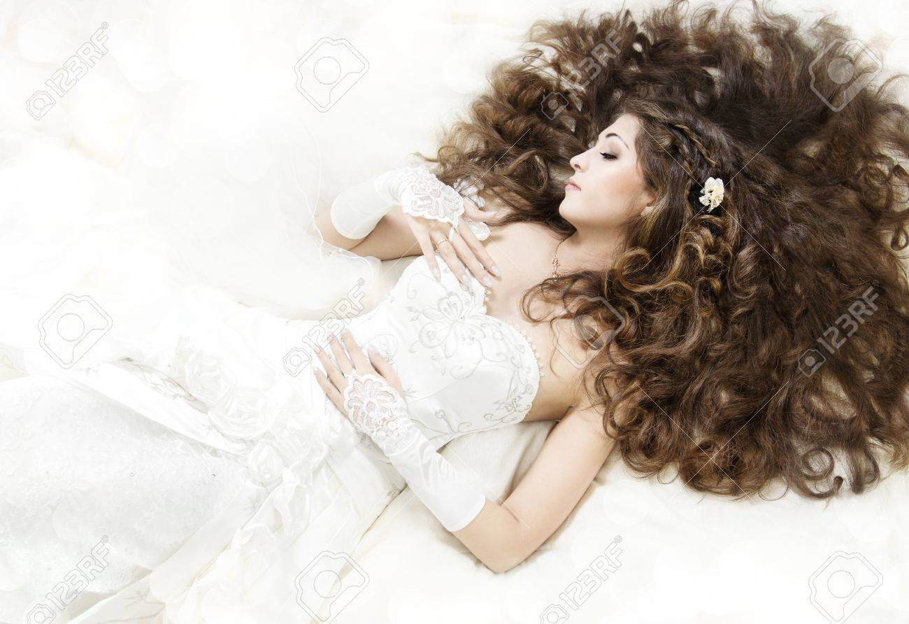 Dreaming Bride With Long Curly Hair Lying Down Over White. Sleeping ...