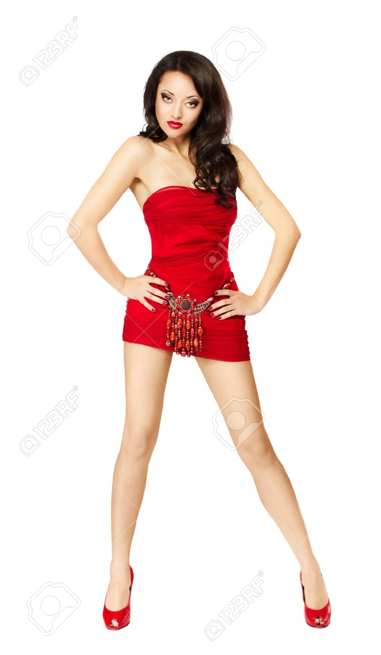 Beautiful woman in red dress standing provocative. Hands on hips. Isolated Stock Photo - 15174273