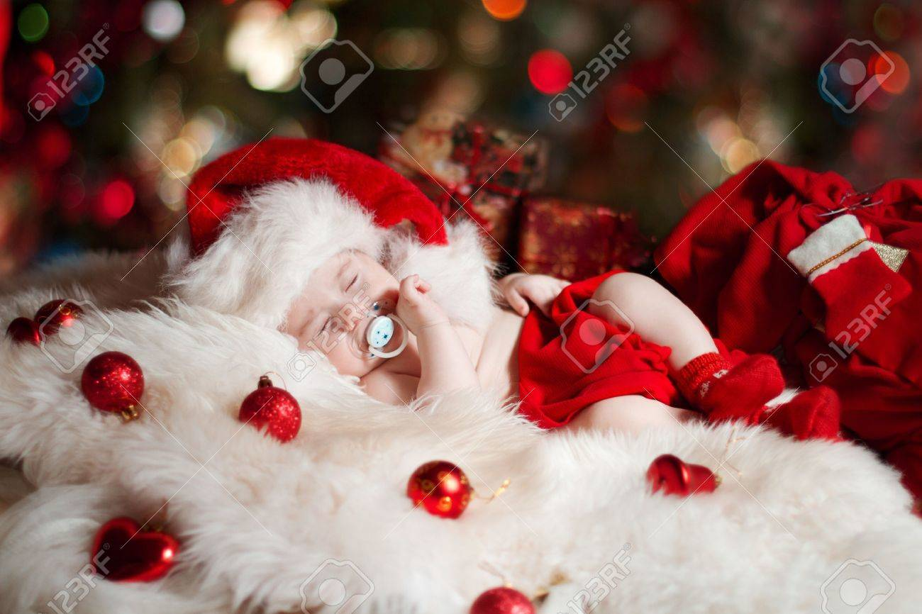 Newborn Christmas Pictures.Christmas Newborn Baby Sleeping In Santa Claus Hat As New Year