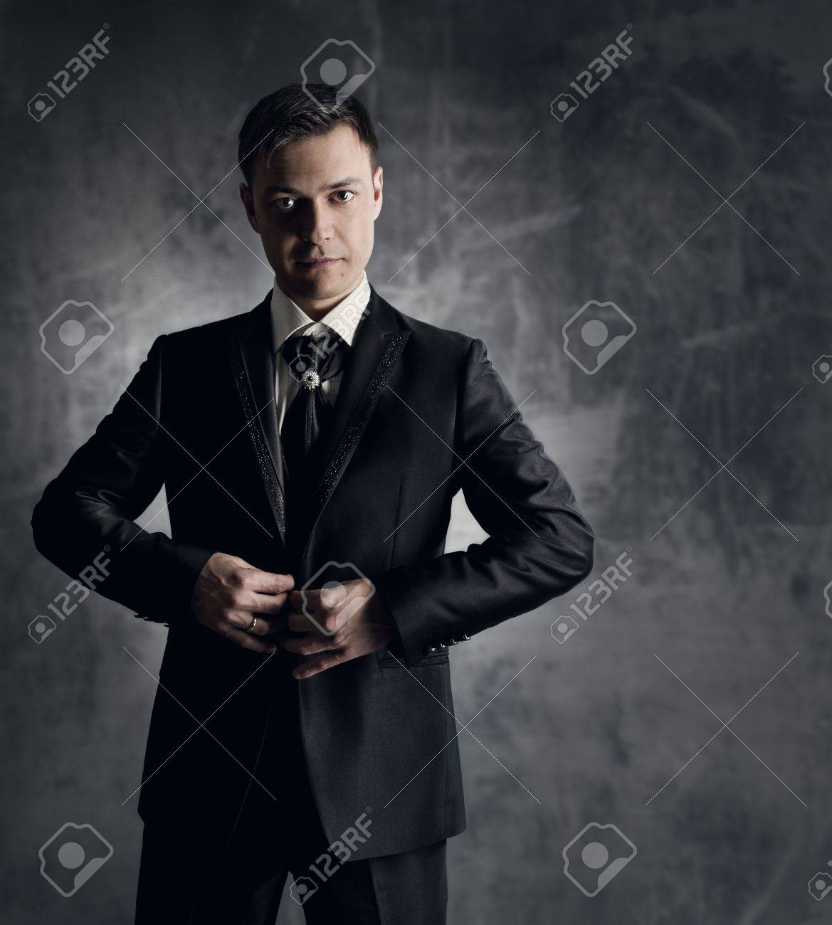 Handsome Man In Black Suit. Wedding Groom Fashion. Gray Background ...