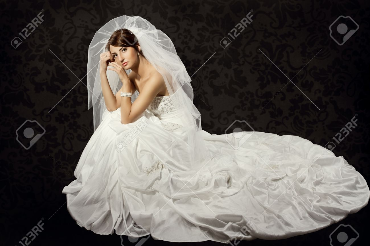 Bride In Wedding Luxury Dress Over Dark Wallpaper Background Stock ...
