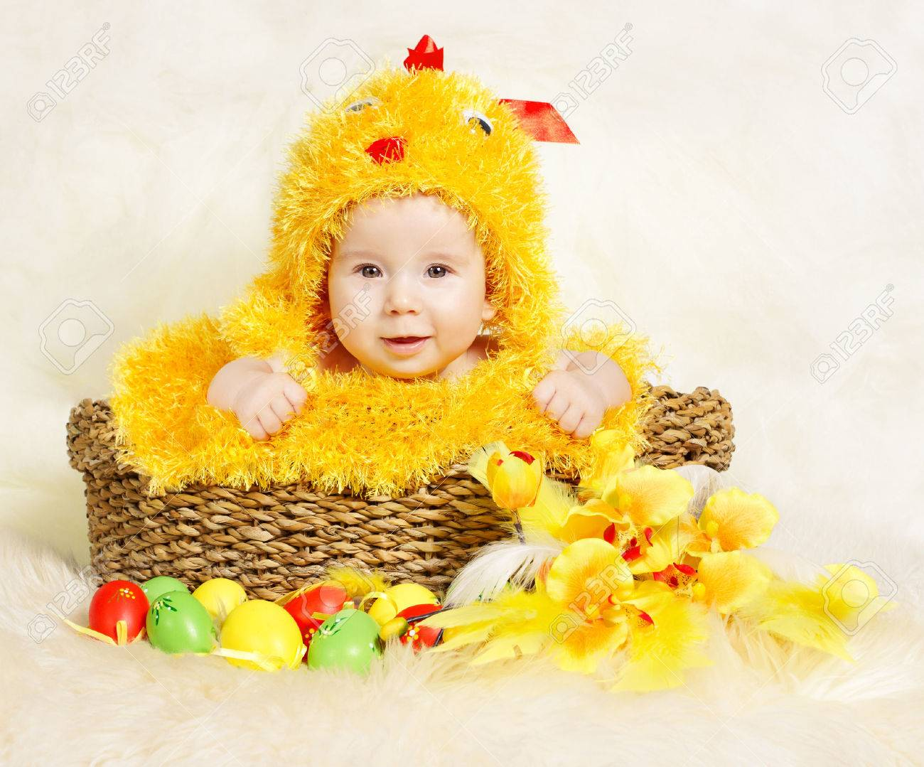 Baby in Easter basket with eggs in chicken costume. Easter holiday concept nest with  sc 1 st  123RF.com & Baby In Easter Basket With Eggs In Chicken Costume. Easter Holiday ...
