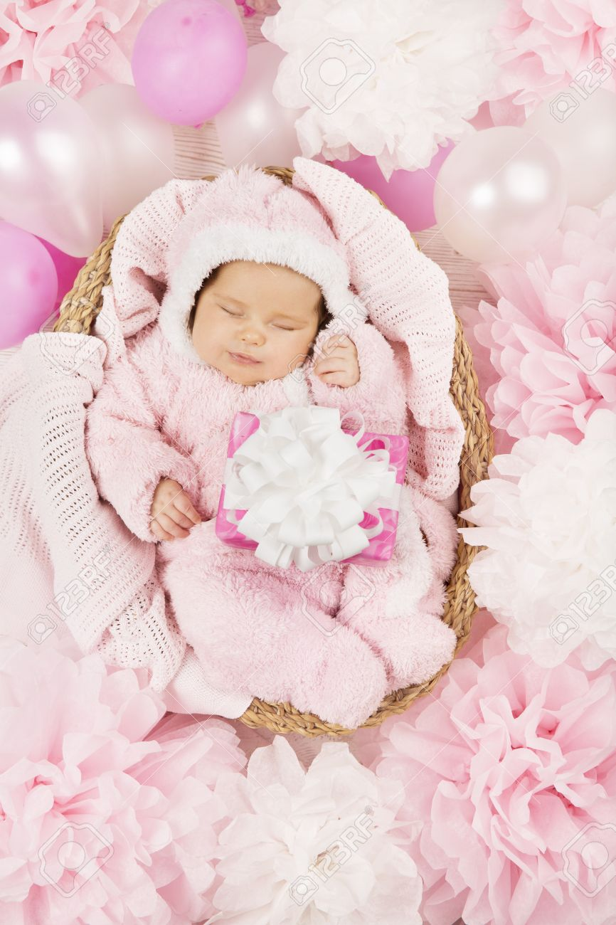 Baby Girl With Gift Sleeping On Pink Background Newborn And Stock