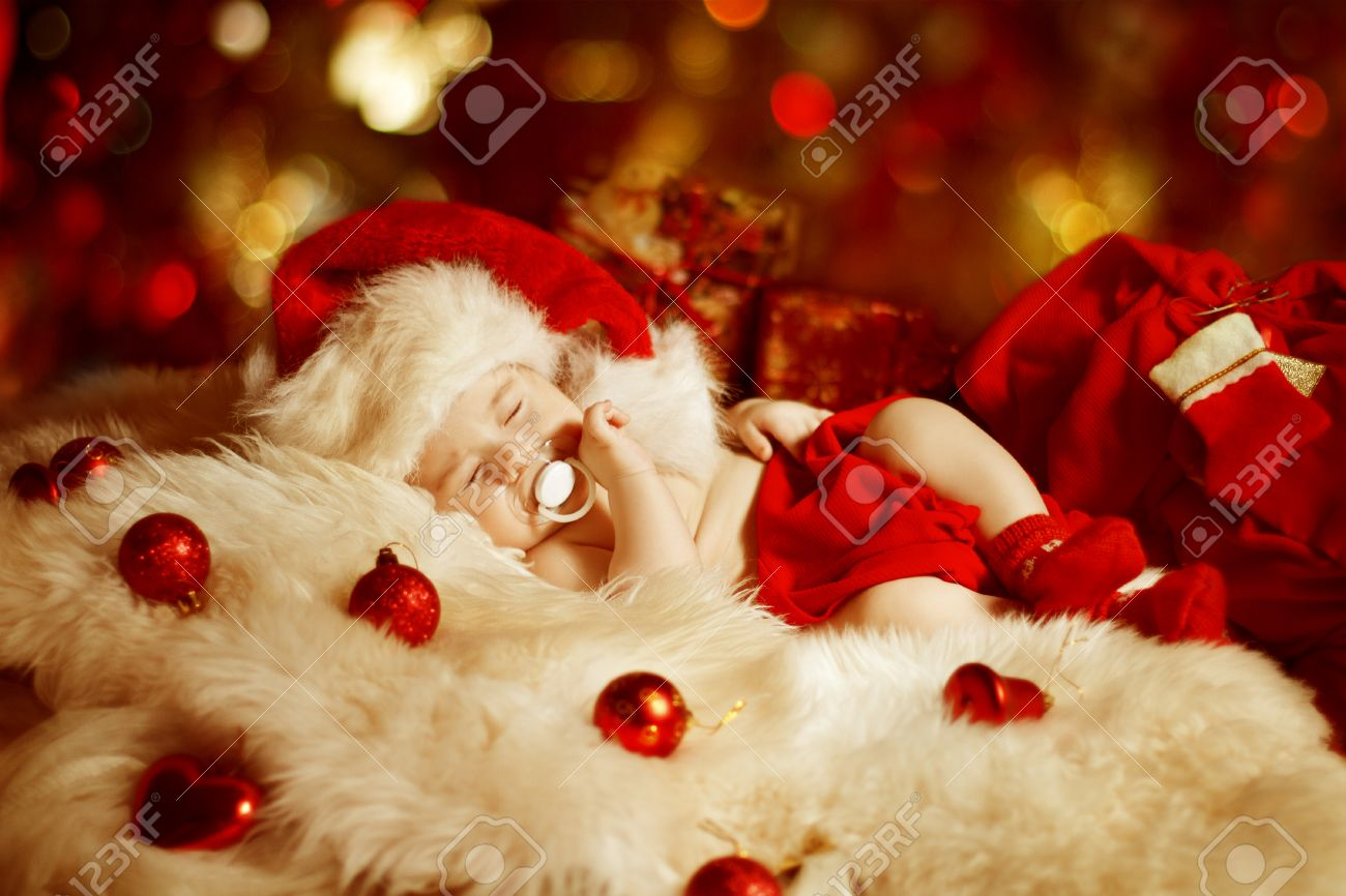 Christmas baby new born kid sleeping as xmas gift in santa hat christmas baby new born kid sleeping as xmas gift in santa hat newborn child negle Choice Image