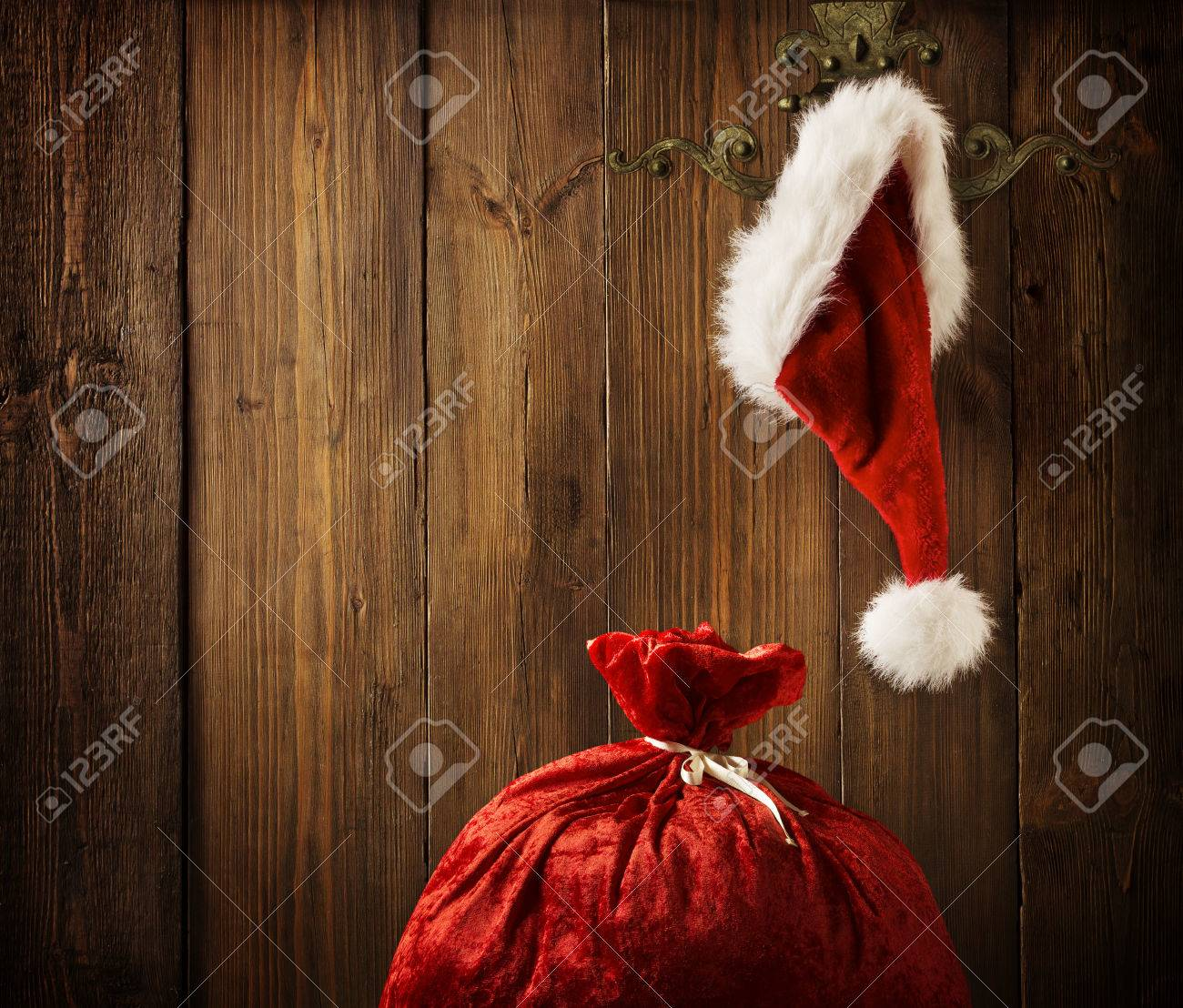 Christmas Santa Claus Hat Hanging On Wood Wall, Xmas Concept, Decoration Over Grunge Wooden Background - 33657183