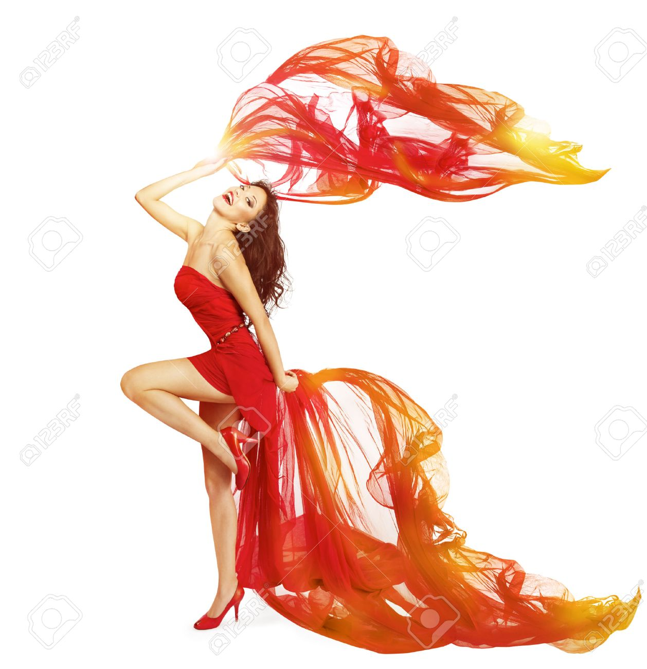 07089c4d3ff7 Stock Photo - Woman Dancing in Red Dress, Cloth Flying Waving on Wind, Dance  Girl Isolated Over White Background