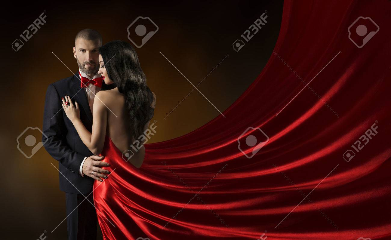 Couple Beauty Portrait, Man in Suit Woman in Red Dress, Rich Lady in Gown, Waving Silk Fabric - 39409338