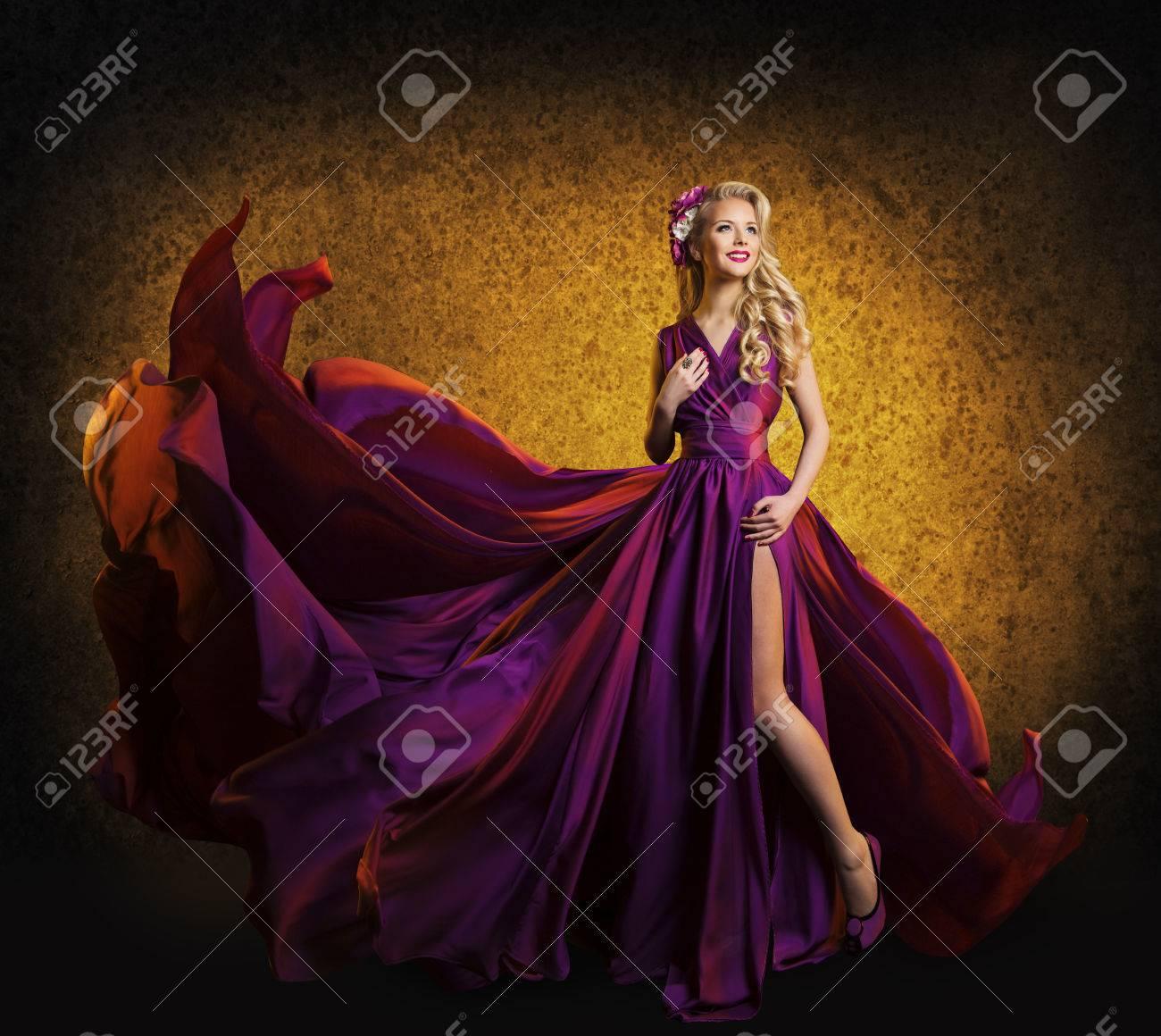 Model In Purple Dress Woman Posing Flying Silk Cloth Waving On Wind Beauty