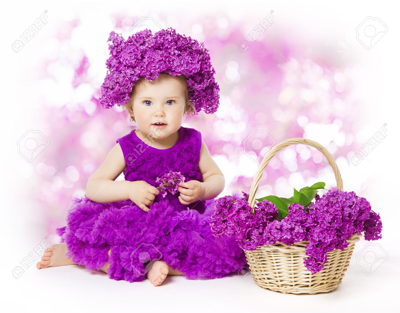 Baby girl lilac flowers little kid in flower crown hat child and bouquet basket