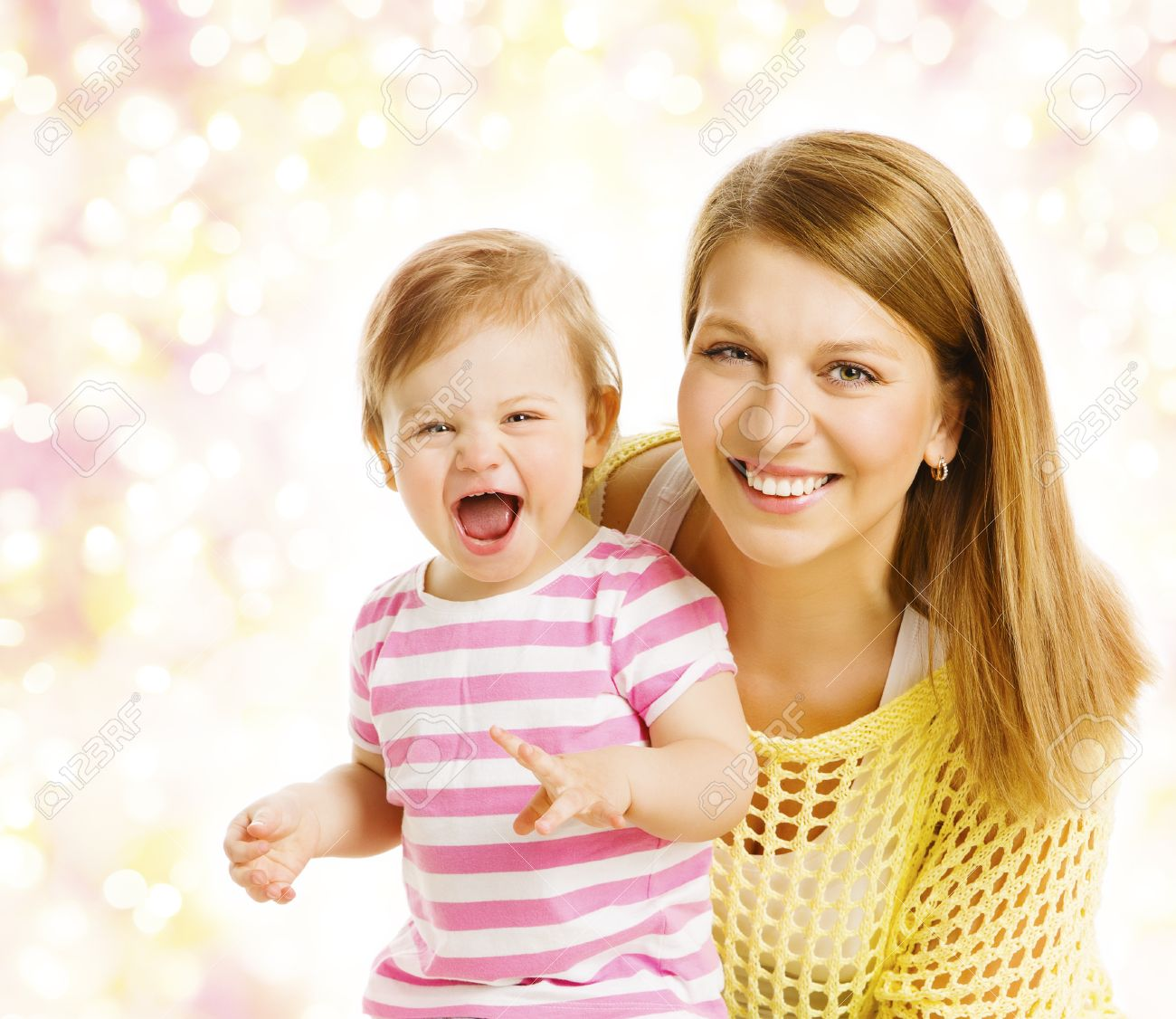 Mother and baby girl family portrait smiling woman with happy laughing kid daughter one