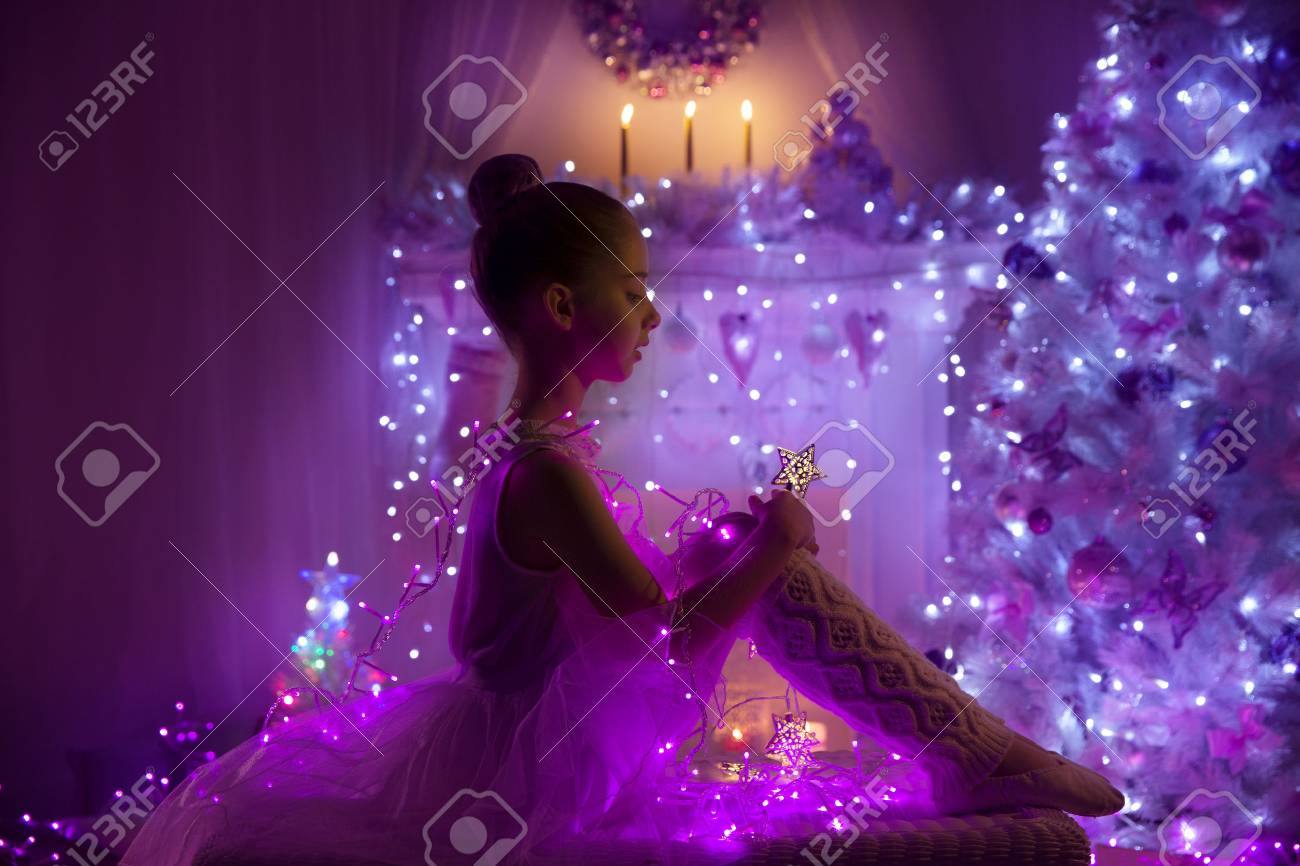 girl child as angel with fairy star christmas tree lights cute kid in holiday - Purple Christmas Tree Lights