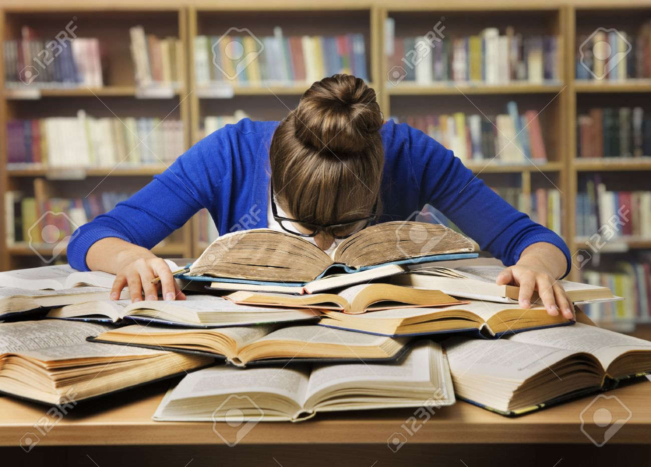 Student Studying Hard Exam and Sleeping on Books, Tired Girl Read Difficult Book in Library - 55589706
