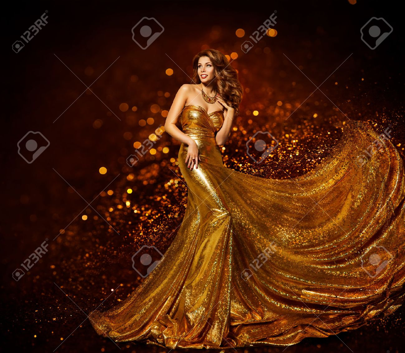 Fashion Woman Gold Dress, Luxury Girl in Elegant Golden Fabric Gown, Flying Sparkles Cloth - 68903872