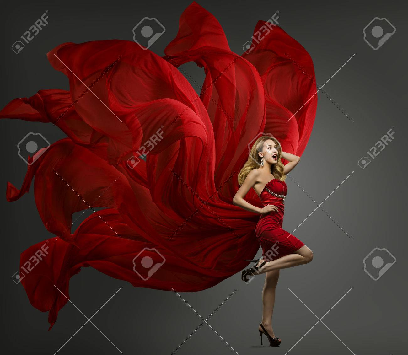 Fashion Model Red Dress, Woman Dancing in Flying Fabric Gown, Waving Fluttering Cloth - 68915132