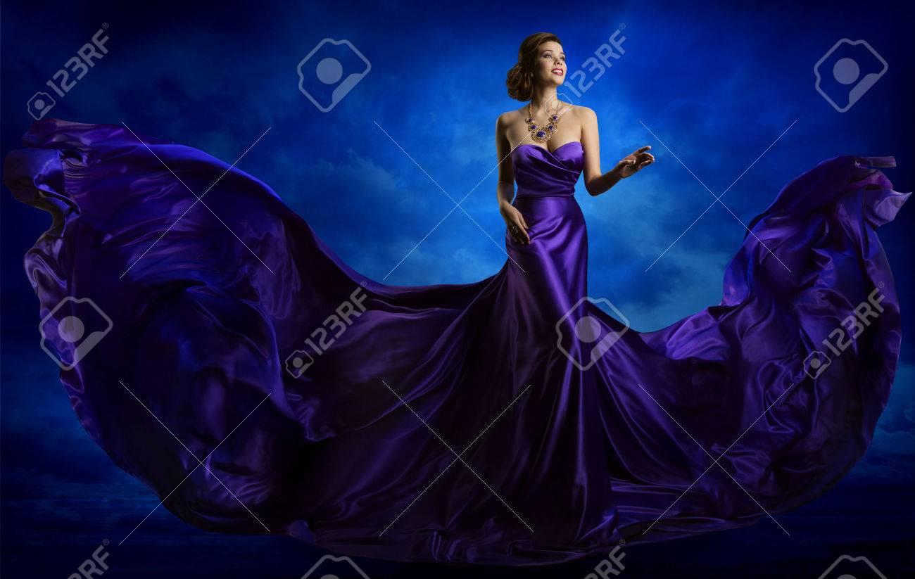 Woman Fashion Dress, Blue Art Gown Flying Silk Fabric, Elegant Model in Waving Purple Cloth - 73017372