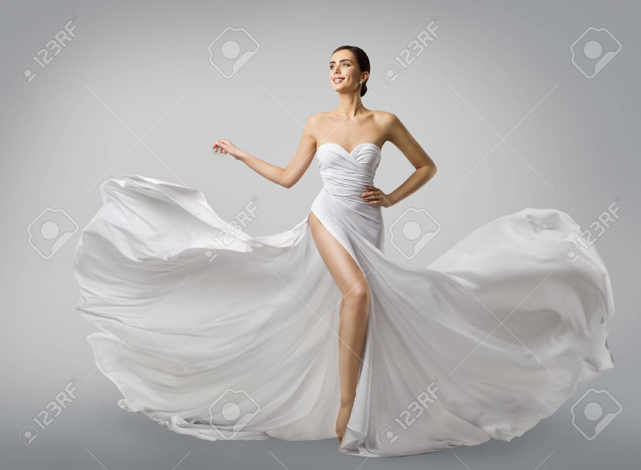 c7460d664 Stock Photo - Woman White Dress, Fashion Model Bride in Long Silk Wedding  Gown, Elegant Flying Fabric, Fluttering Cloth