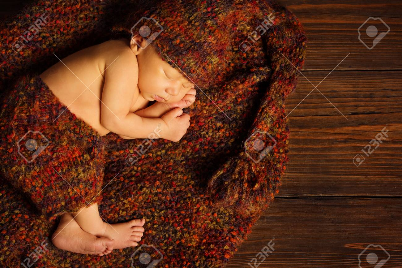 Newborn baby sleep beautiful sleeping infant kid boy lying on brown wool clothing stock photo