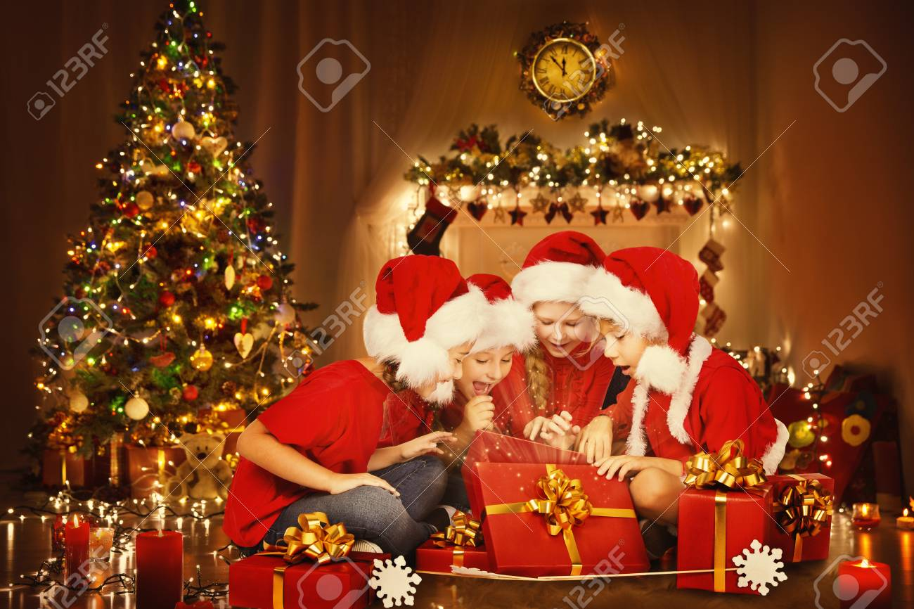 Christmas Children Open Present Gift Box, Happy Kids Opening.. Stock ...