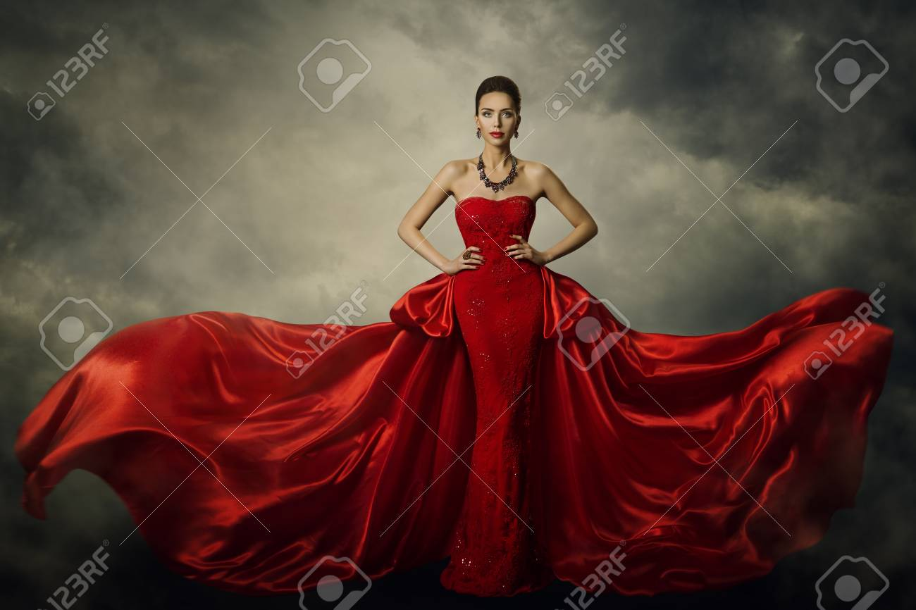 Fashion Model Art Dress, Elegant Woman Standing in Red Retro Gown, Silk Fabric Fluttering over Storm Sky Background - 90693375