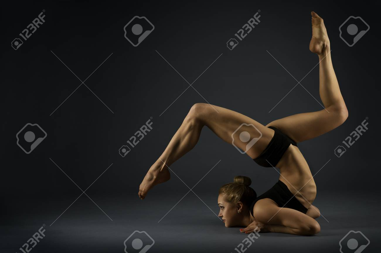Stock Photo - Yoga Gymnastics Pose, Woman Flexible Body, Gymnast Balance in  Backbend Exercise, Acrobat Back Bend Position, Girl Posing on Black  Background
