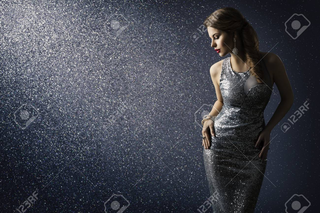 Silver Dress, Fashion Model Posing in Sparkling Sexy Gown, Elegant Woman Beauty Portrait on Lighting Sparkles Background - 97839046