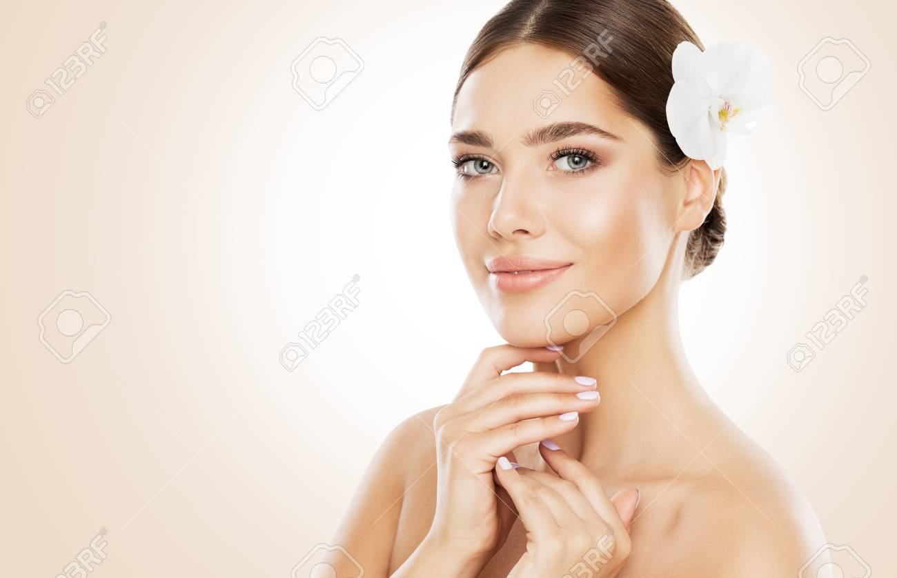 Woman Beauty Face Skin Care And Natural Make Up Girl With Orchid Stock Photo Picture And Royalty Free Image Image 101556645