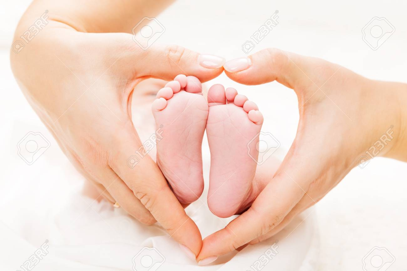 Newborn Baby Feet in Mother Hands Heart, Mom and New Born Kid Foot, Love and Health Care - 123021486