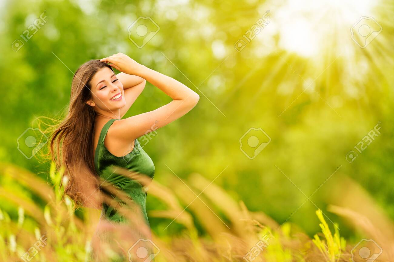 Outdoor Portrait of Happy Young Woman in Nature. Attractive Girl in Sunny Summer Green Park - 144988363