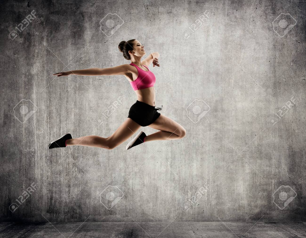 Beautiful Woman Jumping in Sport Dance, Young Happy Girl flying in Jump, Gymnastics Fitness Exercise - 155430327
