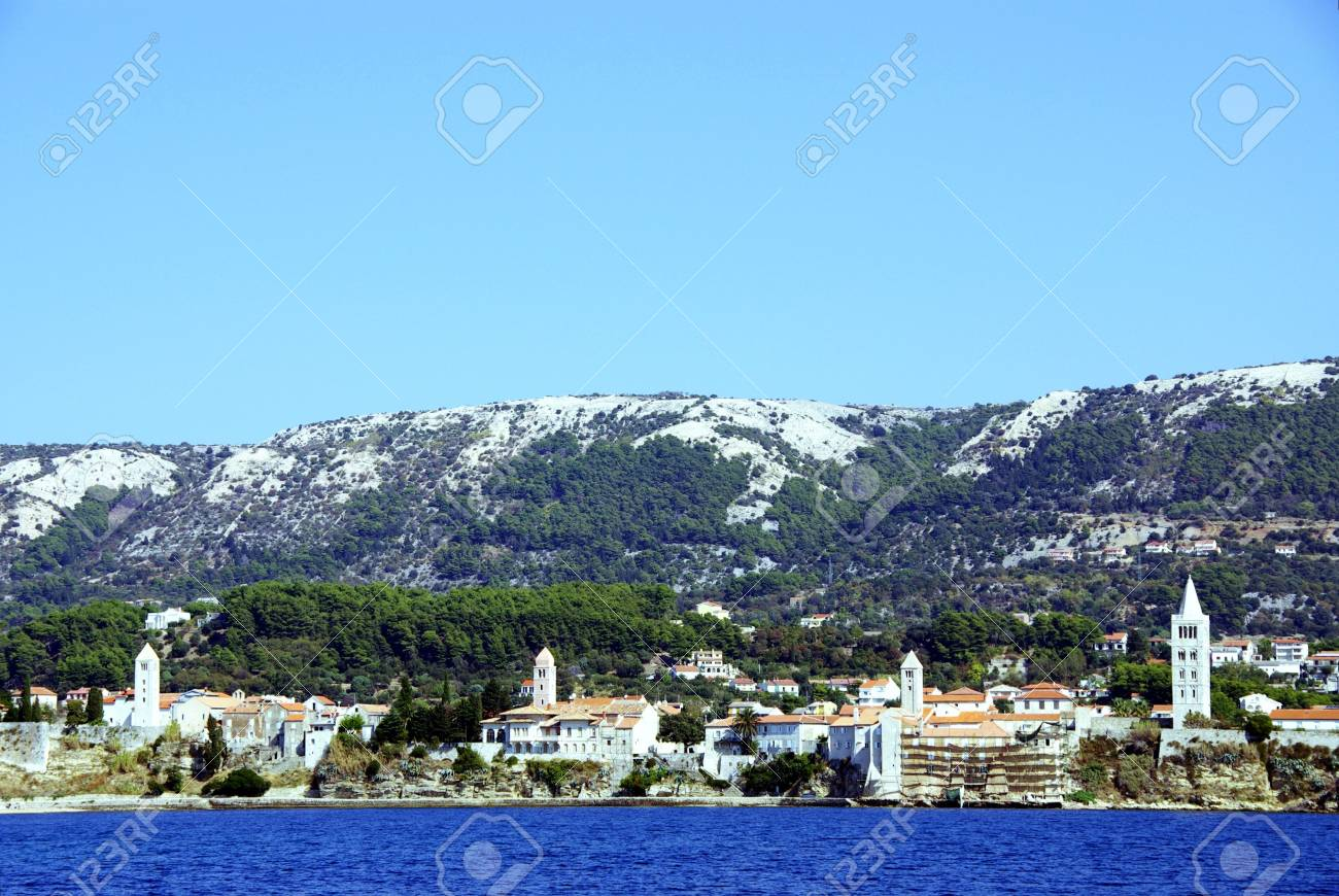 The four bell towers of Rab town at Rab island in Croatia Stock Photo - 4097201