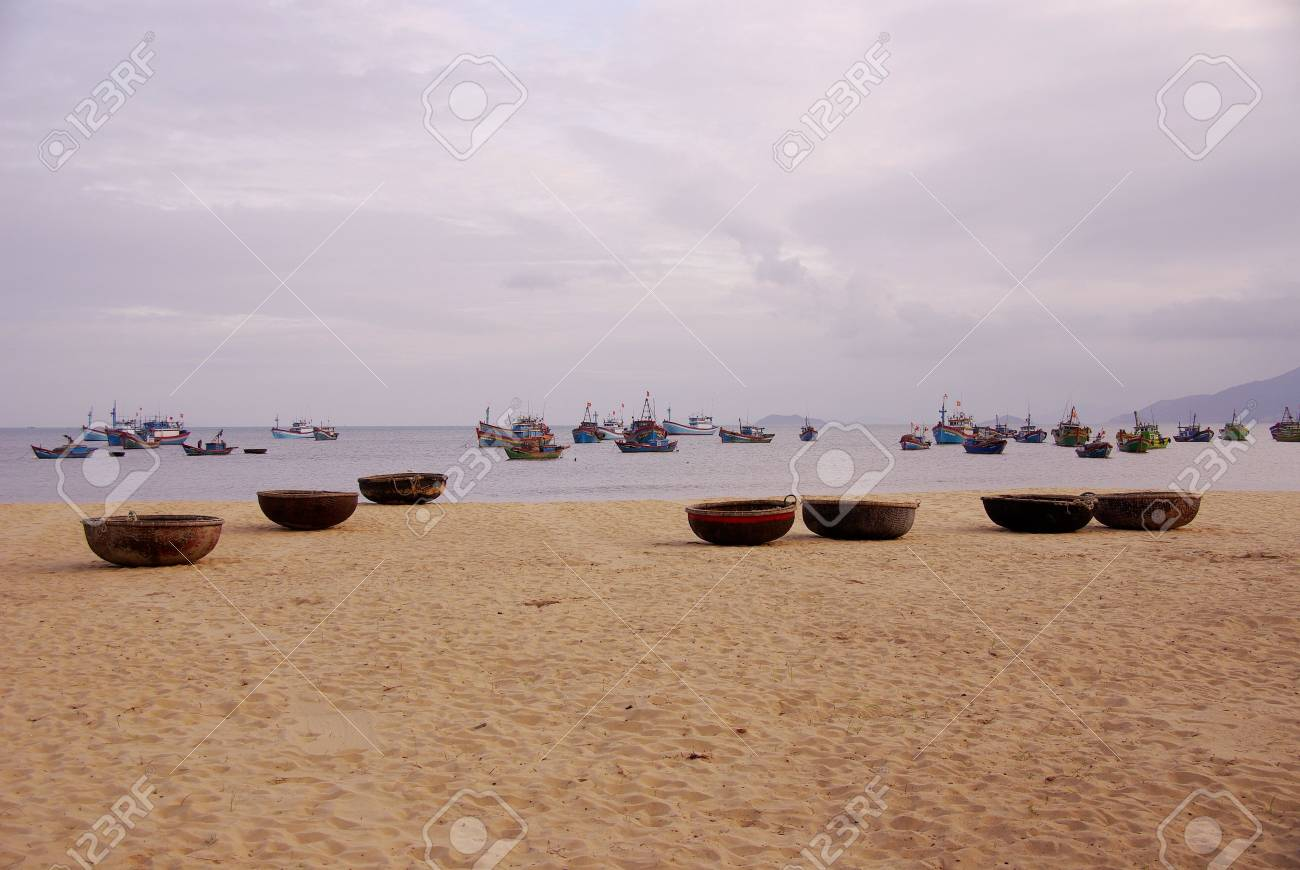 Fishing baskets and boats at Qui Nhon in Vietnam Stock Photo - 4409386