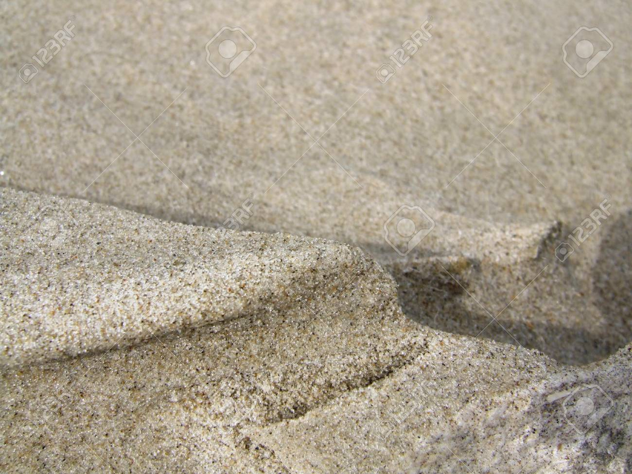 Wind pattern in the sand of a beach Stock Photo - 11768659