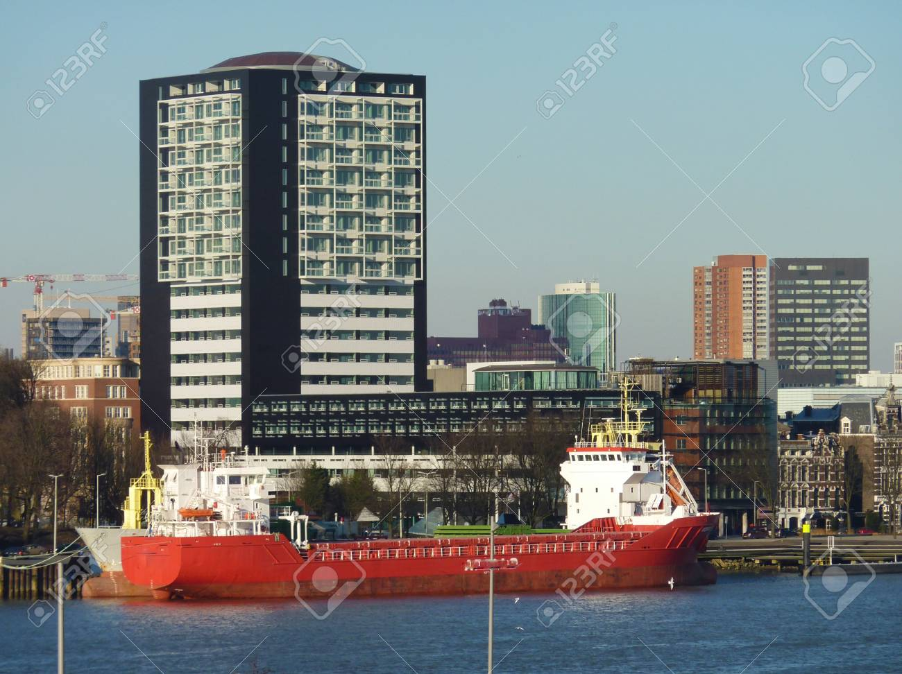 Skyscrapers and a ship along the river Meuse in Rotterdam in the Netherlands Stock Photo - 12378169