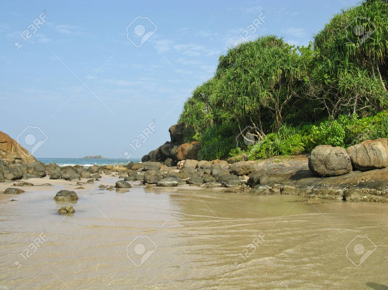 The beach with the rocks and vegetation and the Indian ocean in Sri Lanka Stock Photo - 18288683