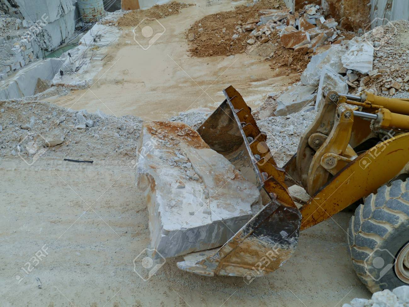 A block white marble on a shovel Stock Photo - 18856946