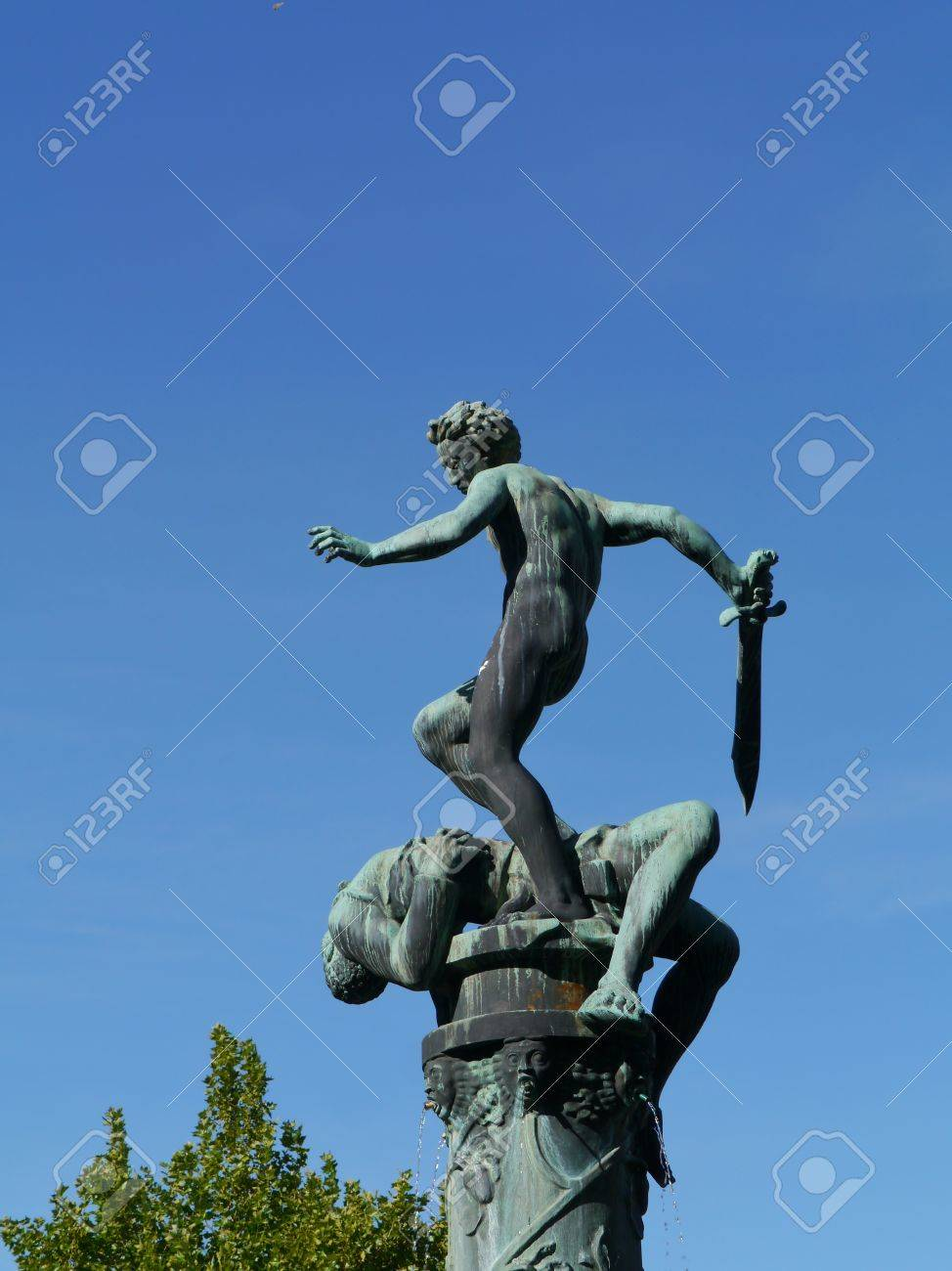 a fountain with a sculpture david and goliath of bronze in the