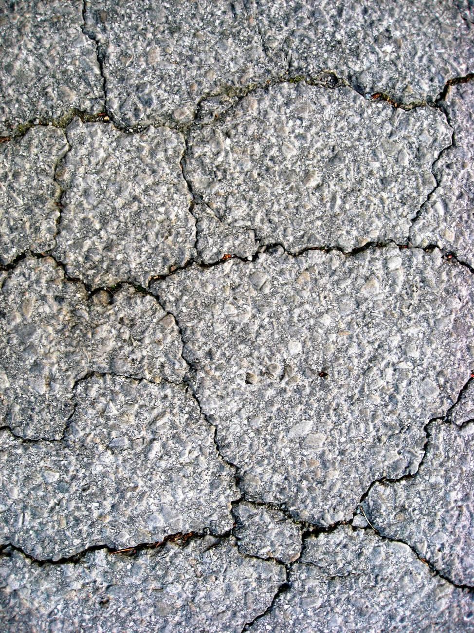 Cracks on asphalt background Stock Photo - 7560763