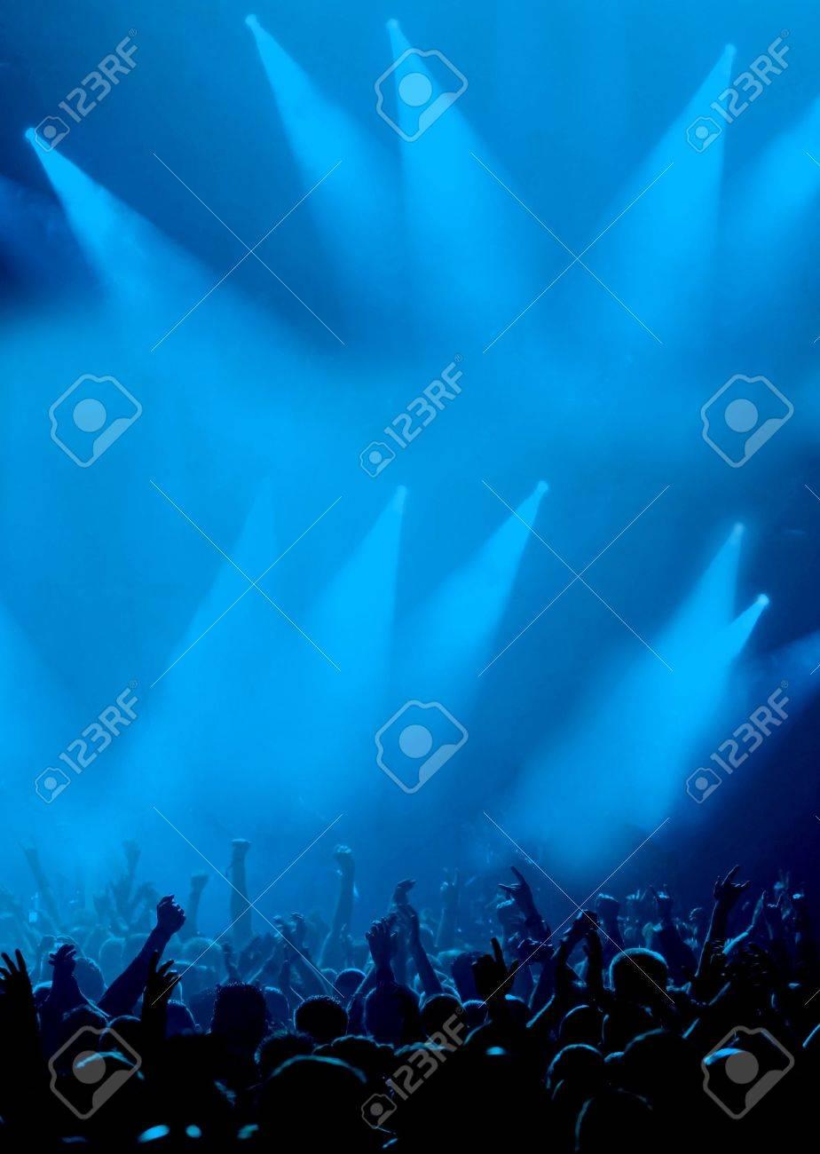 Black Concert Crowd and strange blue Light Stock Photo - 4363169