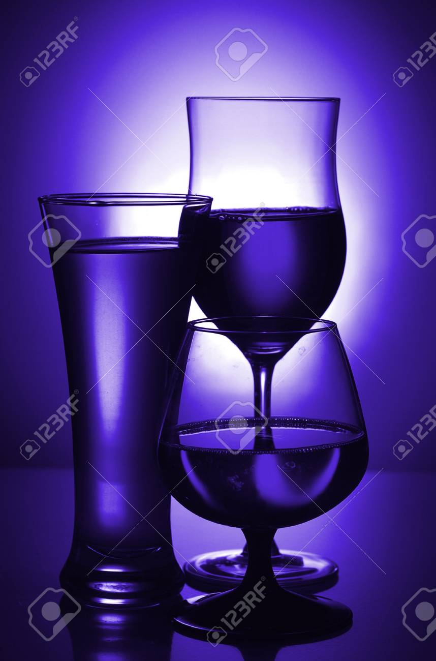 Silhouettes of glasses in blue. Toning. Stock Photo - 15900073