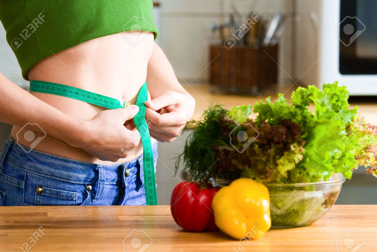 Measure tape around slim beautiful waist Stock Photo - 7299095