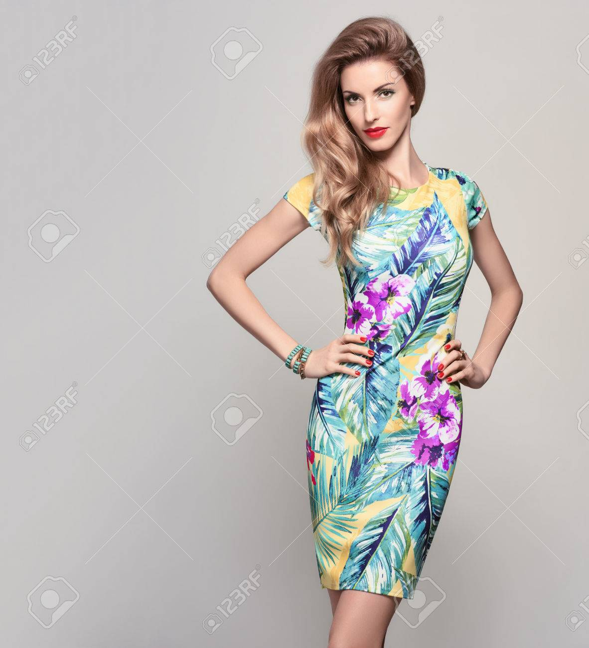 37ff8f0225a Fashion Woman In Trendy Spring Summer Dress. Stylish Wavy Hairstyle ...