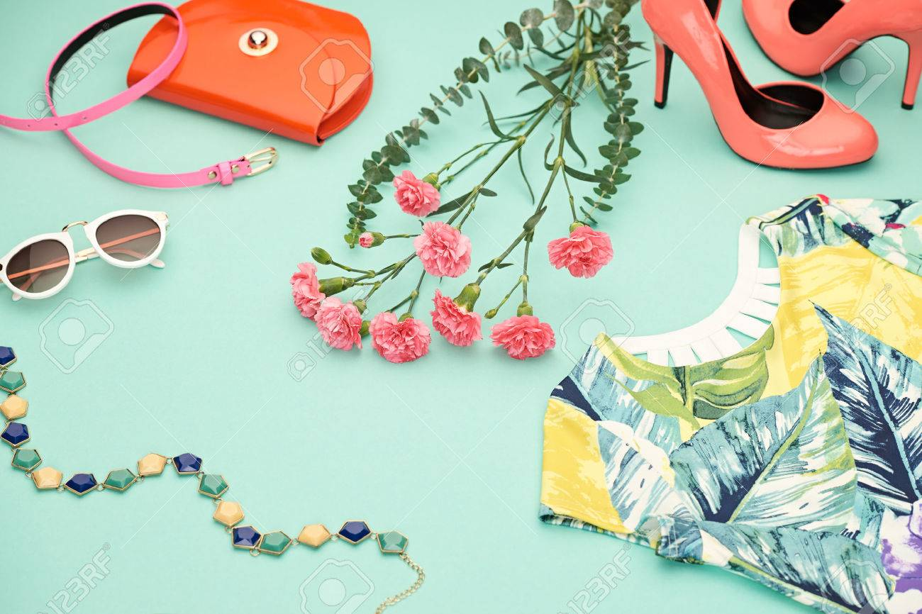 Fashion Design Spring girl clothes set,accessories. Trendy sunglasses, floral dress, fashion handbag clutch, flowers.Glamor shoes heels Summer lady.Creative urban.Pastel spring colors.Perspective view Stock Photo - 73245482