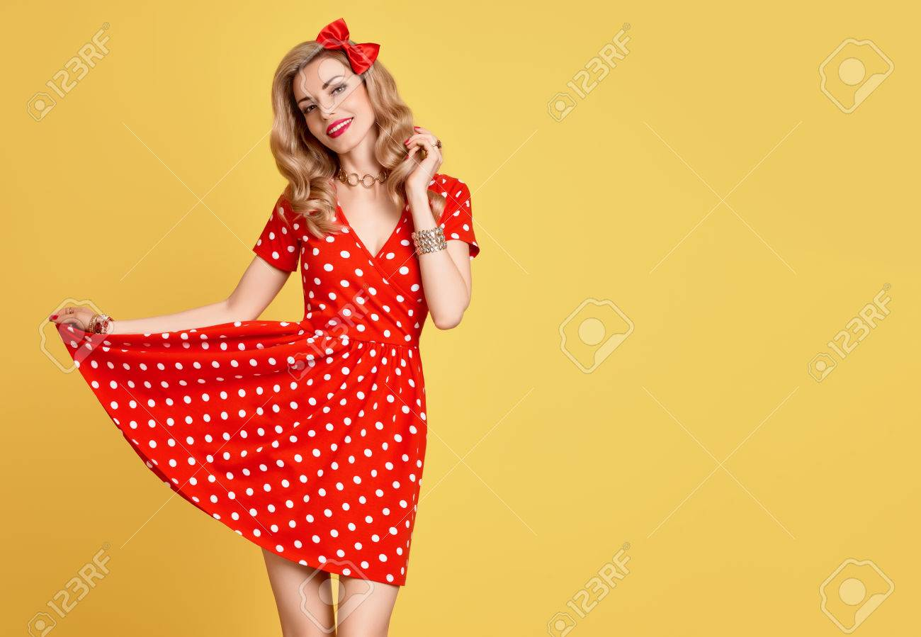 d629e368a Glamour Playful Sexy pinup Model Lady. Fashion Beauty. PinUp Sensual Blond  Girl Smiling in Red Polka Dots Summer Dress. Woman