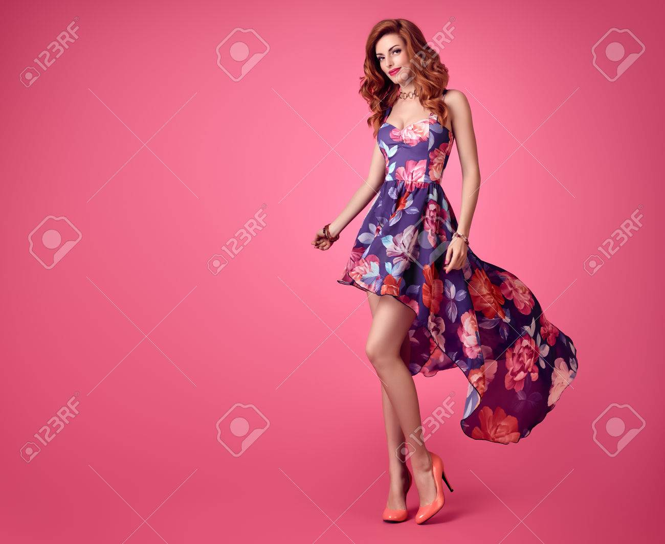 c96b175386 Sensual Sexy Redhead woman in Fashion Trendy Floral summer Dress Smiling. Beauty  Model in fashion