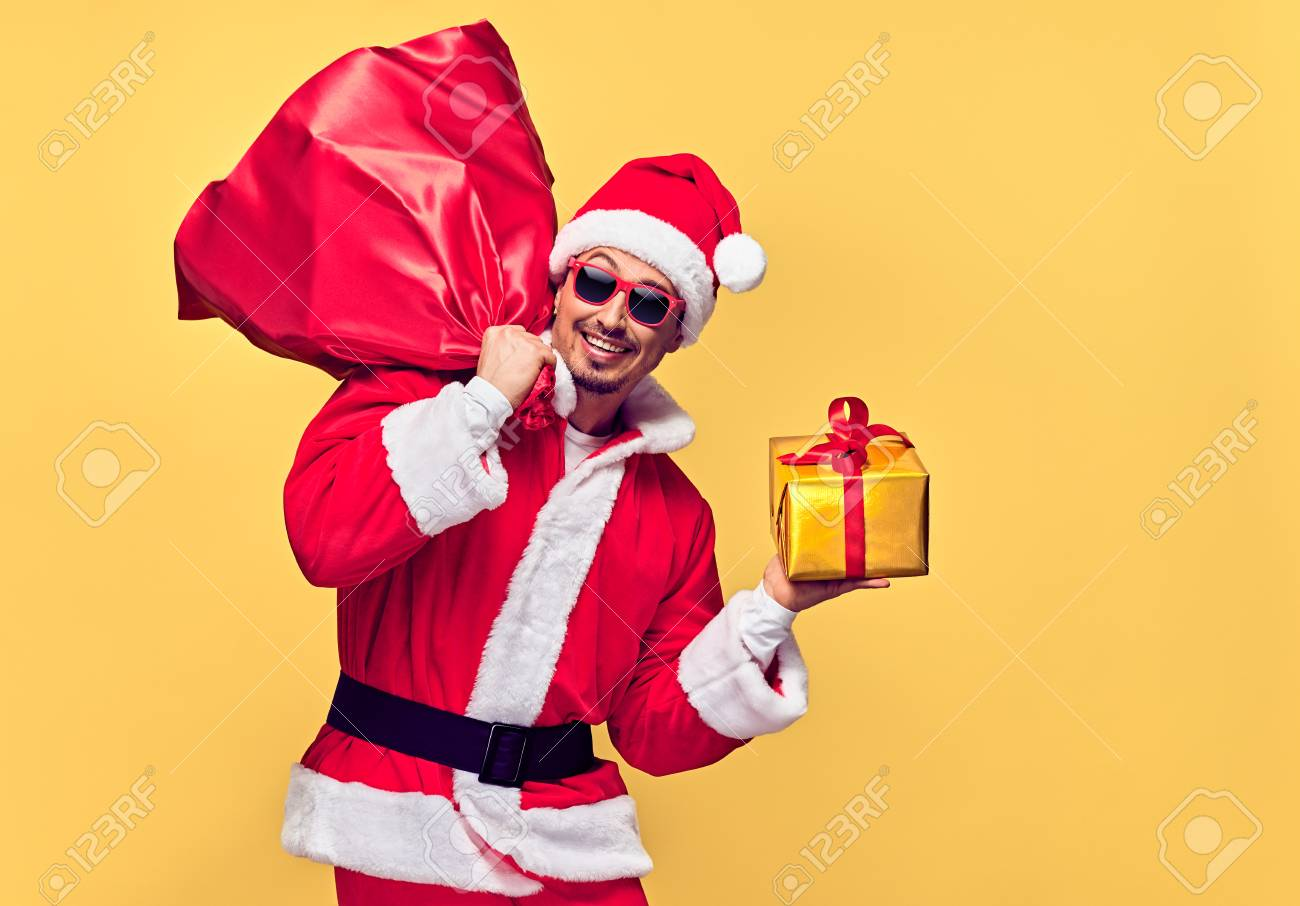 Santa Claus. Young Happy Santa Man. Christmas Santa sack bag..