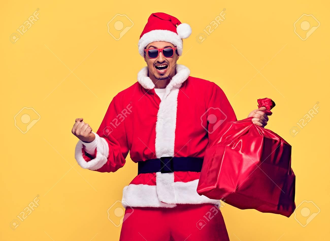 Santa Claus. Young Happy Santa Man Winner Gesture. Handsome Fashion..
